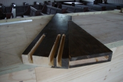 New timber with connection slots for steel rods
