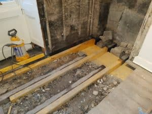Dry rot affected joists being repaired